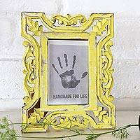 Wood photo frame, 'Sunlit Day' (4x6) - Distressed Yellow Hand Carved Mango Wood Photo Frame (4x6)