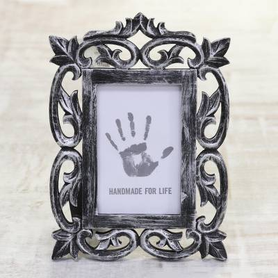 Wood photo frame, 'Noble Portrait' (4x6) - Hand Carved Distressed Black Mango Wood Photo Frame (4x6)