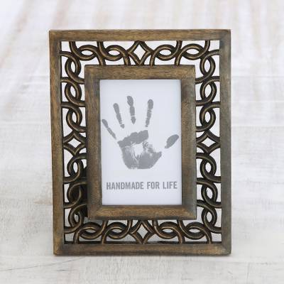 Wood photo frame, 'Interlinked' (4x6) - Wood Hand Carved Cutouts Rectangular Photo Frame (4x6)