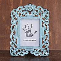 Wood photo frame, 'Wrapped in Blue' (5x7) - Blue Distressed Hand Carved Mango Wood Photo Frame 5x7