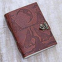 Leather journal, 'Wintry Night' - Handcrafted Howling Wolves Embossed Dark Red Leather Journal