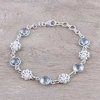 Blue topaz link bracelet, 'Cerulean Garden' - Floral 9.5-Carat Blue Topaz Link Bracelet from India