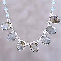 Labradorite pendant necklace, 'Enchanting Mystery' - Faceted Oval Labradorite and Chalcedony Pendant Necklace
