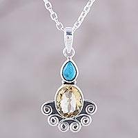Citrine pendant necklace, 'Sun Salutations' - Citrine Oval and Sterling Silver Scrollwork Pendant Necklace