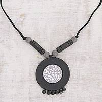Ceramic pendant necklace, 'Dancing Disc' - Handcrafted Ceramic Pendant Necklace from India