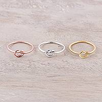 Sterling silver and gold plated band rings, 'Heavenly Knots' (set of 3) - Gold Plated Rose Gold and Sterling Silver Band Rings (3)