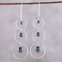 Sterling silver dangle earrings, 'Circular Beauty' - Circular Sterling Silver and Hematite Earrings from India