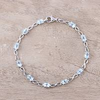 Blue topaz link bracelet, 'Glimmer and Sparkle' - Sterling Silver and Faceted Blue Topaz Link Bracelet