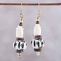 Bone beaded dangle earrings, 'Enigmatic Expressions' - Hand-Carved Natural Bone Dangle Earrings from India
