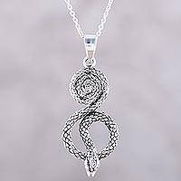 Sterling silver pendant necklace, 'Serpent Swirl' - Serpentine Snake Sterling Silver Pendant Necklace from India