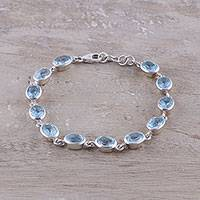Blue topaz link bracelet, 'Sea Luster' - 18-Carat Blue Topaz Link Bracelet Crafted in India
