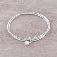 Sterling silver bangle bracelet, 'Gleaming Connection' - Triple-Band Sterling Silver Bangle Bracelets from India