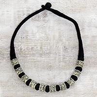 Buffalo bone beaded necklace, 'Storytelling' - Ivory Color Buffalo Bone Bead on Black Cotton Cord Necklace