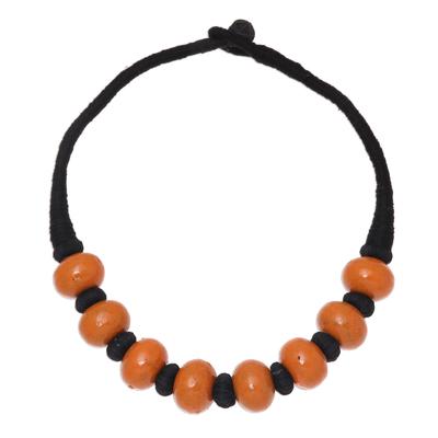 Bone beaded necklace, 'Shining Sand' - Brown Buffalo Bone Bead on Black Cotton Cord Necklace