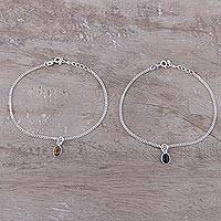 Onyx and tiger's eye charm bracelets, 'Dainty Duo in Brown and Black' (pair) - Tiger's Eye and Onyx Sterling Silver Charm Bracelets (Pair)