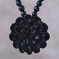 Ebony wood beaded pendant necklace, 'Marigold Shadow' - Ebony Wood Marigold Flower Beaded Pendant Necklace