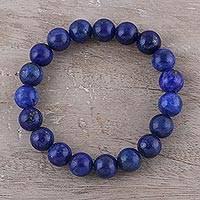 Lapis lazuli beaded stretch bracelet, 'Starry Universe' - Handmade Lapis Lazuli Elastic Beaded Bracelet from India