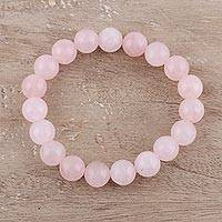 Rose quartz beaded stretch bracelet, 'Pink Dawn' - Handmade Rose Quartz Beaded Stretch Bracelet from India