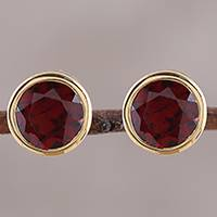 Gold plated garnet stud earrings, 'Sparkling World' - Handcrafted 22k Gold Plated Faceted Garnet Stud Earrings