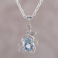 Blue topaz pendant necklace, 'Shimmering Daybreak' - Handcrafted Blue Topaz and Sterling Silver Pendant Necklace