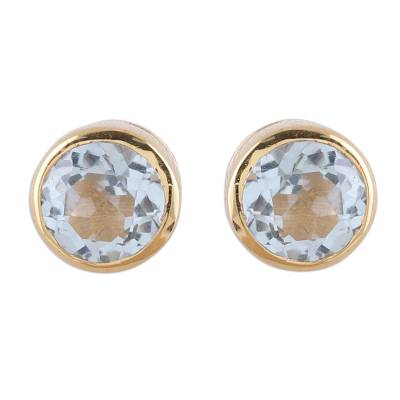 Gold plated blue topaz stud earrings, 'Sparkling World' - 22k Gold Plated Faceted Blue Topaz Stud Earrings from India