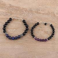 Lapis lazuli and amethyst beaded bracelets, 'Beautiful Couple' (pair) - Lapis Lazuli and Amethyst Beaded Bracelets from India (Pair)
