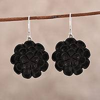 Ebony wood dangle earrings, 'Marigold Shadow' - Hand-Carved Ebony Wood Marigold Dangle Earrings from India