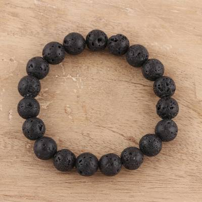Lava stone beaded stretch bracelet, 'Volcanic Beauty' - Natural Lava Stone Beaded Stretch Bracelet from India