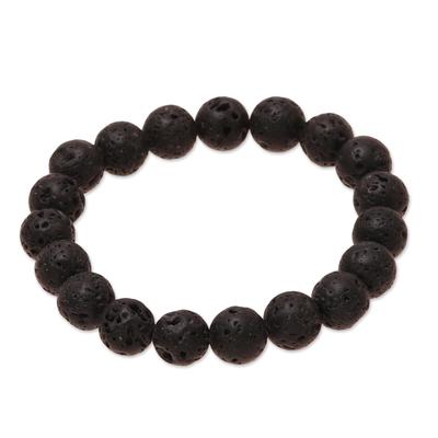 Lava stone beaded stretch bracelet, 'Volcanic Beauty' - Natural Lava Stone Beaded Stretch Bracelet from India