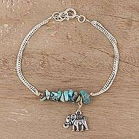 Sterling silver and composite turquoise bracelet, 'Dangling Elephant' - Sterling Silver and Composite Turquoise Elephant Bracelet