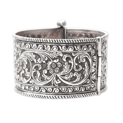 Sterling silver bangle bracelet, 'Rajasthan Classic' - Floral Sterling Silver Bangle Bracelet from India