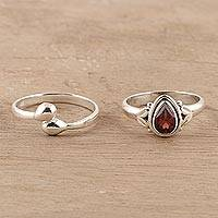 Garnet and sterling silver rings, 'Gemstone Radiance' (pair) - Garnet and Sterling Silver Rings Crafted in India (Pair)