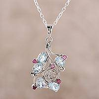 Rhodium plated blue topaz and ruby pendant necklace, 'Delightful Berries' - Rhodium Plated Blue Topaz and Ruby Pendant Necklace
