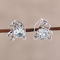 Rhodium plated blue topaz stud earrings, 'Leafy Glisten' - Rhodium Plated Blue Topaz Stud Earrings from India