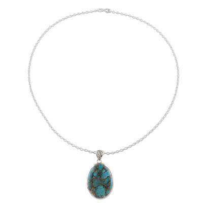 Sterling silver and composite turquoise pendant necklace, 'Glittering Island' - Oval Sterling Silver and Composite Turquoise Necklace