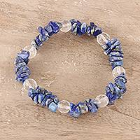 Lapis lazuli and quartz beaded stretch bracelet, 'Lake Charm' - Lapis Lazuli and Clear Quartz Beaded Stretch Bracelet