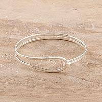Sterling silver bangle bracelet, 'Shining Flair' - High-Polish Sterling Silver Bangle Bracelet from India