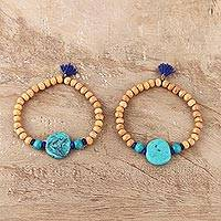 Wood and resin beaded stretch bracelets, 'Royal Friends' (pair) - Blue Tassel Wood and Resin Beaded Stretch Bracelets (Pair)