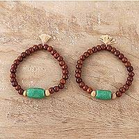 Wood and resin beaded stretch bracelets, 'Friendship Harmony' (pair) - Wood and Green Resin Beaded Stretch Bracelets (Pair)