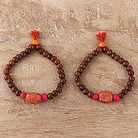 Wood and resin beaded stretch bracelets, 'Friendship Beads' (pair) - Wood and Orange Resin Beaded Stretch Bracelets (Pair)