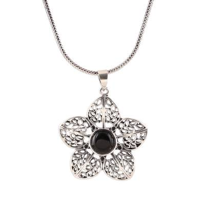 Onyx pendant necklace, 'Delightful Midnight' - Floral Onyx Pendant Necklace from India