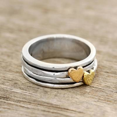 Sterling silver spinner ring, 'Traveling Hearts' - Heart Motif Sterling Silver and Brass Spinner Ring