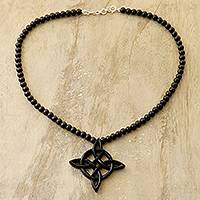 Ebony wood beaded pendant necklace, 'Fascinating Faith' - Celtic Cross Ebony Wood Beaded Pendant Necklace from India