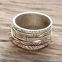 Sterling silver spinner ring, 'Moving Patterns' - Patterned Sterling Silver Spinner Ring with Brass and Copper