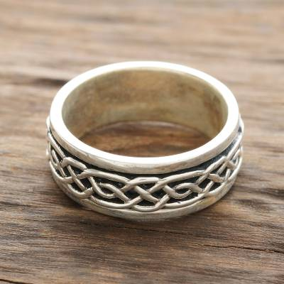 Sterling silver spinner ring, 'Celtic Illusion' - Celtic Pattern Sterling Silver Spinner Ring from India