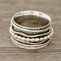 Sterling silver spinner ring, 'Dotted Flair' - Patterned Sterling Silver Spinner Rig with Brass and Copper