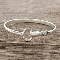 Sterling silver bangle bracelet, 'Horseshoe Fortune'