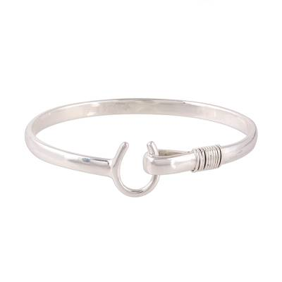 Sterling silver bangle bracelet, 'Horseshoe Fortune' - Sterling Silver Horseshoe Bangle Bracelet from India
