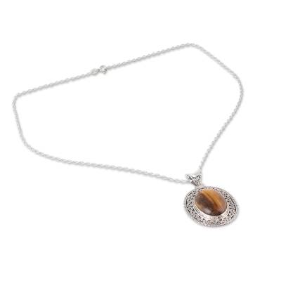 Tiger's eye pendant necklace, 'Dancing Earth' - Oval Tiger's Eye Pendant Necklace from India
