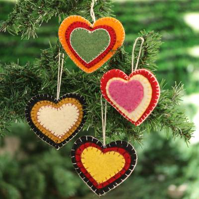 Wool felt ornaments, 'Entrancing Hearts' (set of 4) - Colorful Wool Felt Heart Ornaments from India (Set of 4)
